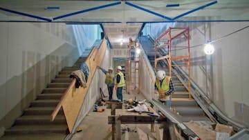Installation of Kauffman Center interior metalwork by Zahner field operators.