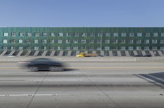 Green interference coated stainless steel facade of Team Disney Anaheim.