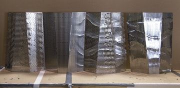 Custom formed and perforated metal