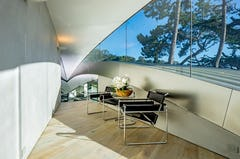 Interior fascia in stainless steel provides an ambient reflectivity.