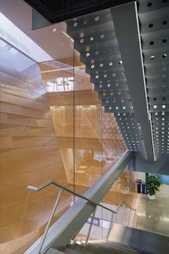 Atrium at Gates Hall, shows the interior feature wall installed and fabricated by Zahner.