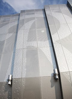 Detail of the perforated metal facade.