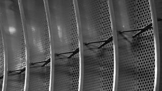 Perforated metal fin