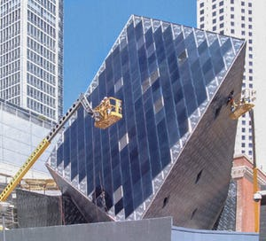 At certain angles the metal panels reflect iridescent colors.