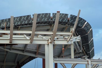 View of the exposed beams which will soon form the upward-curving awning.