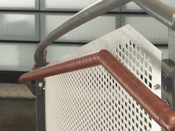 Custom guardrail screens in perforated aluminum