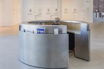 Custom stainless steel reception desk for the Nerman Museum of Contemporary Art