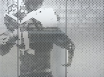 Cross-seam perforation is a standard feature of ImageWall perforated metal.