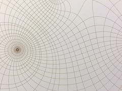 Laser cut terra cotta tile with glaze.