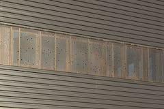 Custom perforated window screens for John Olver Transit Center.