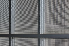 Detail of the interior mullions attachment for the perforated metal aluminum panels