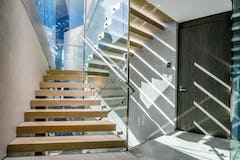 Interior stainless steel accents frame the spaces of the Serenity residence.