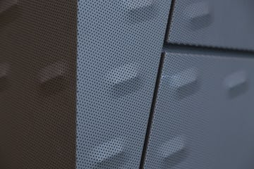 Detail of the punched and custom-embossed zinc acoustic panels at KCPD Headquarters.