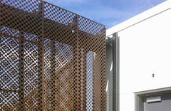 Quatrefoil moire pattern appears in the double-layered perforated metal.