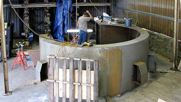 Zahner fabricator grinds edges for oakley desk