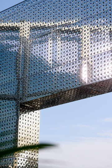 Detail of the custom perforated emboss used to bump and perf the stainless steel facade.