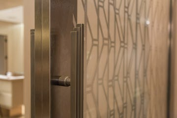 Detail of the bronze door hardware for the custom sliding lounge.