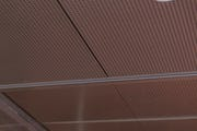 Acoustic metal ceiling panels for entryways.