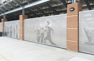 Custom privacy screens provide passive security and vibrant aesthetics for the Okie Blanchard Sports Complex.