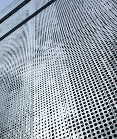 Detail of the perforated metal facade on Fairmont Pacific Rim