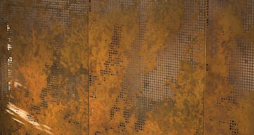 Afternoon light cuts across the copper surface of the Livermore artwork.