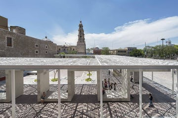 Perforated metal canopy casts shadows at Aguascalientes, Mexico.