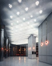Custom aluminum acoustic ceiling panel system.