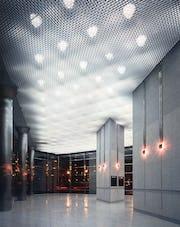 Custom aluminum acoustic ceiling panel system.
