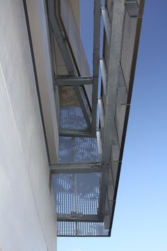 Detail of the perforated zigzag aluminum system used to cool and ventilate the school's parking garage.