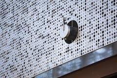Larger perforation for ventilation hardware.