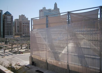 Light filters through the Winds of Aphrodite's aluminum surface on Bartle Hall Loading Dock.