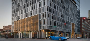 Two perforated metal entry facades for the 1401 Lawrence tower in Denver.