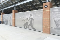 Perforated metal screen wall prevents access to under bleachers without drawing attention to its inherent security.
