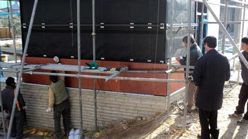 Installation of wall panel systems for Daeyang Gallery and House.